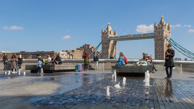 Tourists and fountains near Tower Bridge Stock Photo