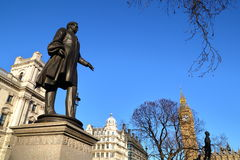 LONDON, UK - MARCH 16, 2014: Viscount Palmerston statue at Parliament Square with Big Ben in the background Stock Images