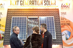 Customers buying solar panels. London, UK - 15 March 2013: visitors ask for information on solar panels during the Ideal Home Show 2013 exhibition Stock Photography