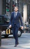 City of London,  walking businessmen  on the street. UK Stock Photos