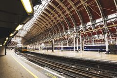 Wide interior view of Paddington station, one of London`s main transportation hubs. London, UK - March 20 2018: Wide interior view of Paddington station, one of stock images