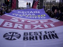 London, UK - Match 23, 2019: Best For Britain social campainers protesting against Brexit. Large`Stop Brexit`banner on the streets of London during anti-Brexit royalty free stock photos