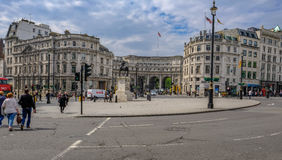 London, UK - May 11, 2017: Admiralty Arch, entrance to the Mall,. Wide angle view with people crossing the road and traffic Stock Images