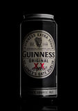 LONDON, UK - MAY 29, 2017: Alluminium can of Guinness original beer on black. Guinness beer has been produced since 1759 in Dublin Royalty Free Stock Image