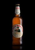 LONDON, UK - MAY 15, 2017: Bottle of Birra Moretti beer on black, Italian brewing company, founded in Udine in 1859 by Luigi Moret Royalty Free Stock Photography