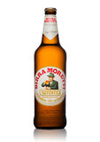 LONDON, UK - MAY 15, 2017: Bottle of Birra Moretti beer on white, Italian brewing company, founded in Udine in 1859 by Luigi Moret Royalty Free Stock Images