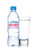 LONDON, UK - MAY 29, 2017: Bottle Of Evian Natural Mineral Water with glass on a white. Made in France. Royalty Free Stock Images