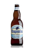 LONDON, UK - MAY 29, 2017: Bottle of Hoegaarden wheat Belgian beer on white. Belgium and the producer of a well-known wheat beer. LONDON, UK - MAY 29, 2017 stock photography
