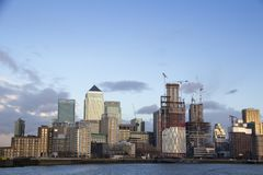 London cityscape across the River Thames with a view of Canary Wharf, London, England, UK, May 20, 2017. LONDON, UK - MAY 20, 2017. London cityscape across the royalty free stock photography