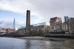 London cityscape across the River Thames with a view of the Shard and Tate Modern, London, England, UK. LONDON, UK - MAY 20, 2017. London cityscape across the royalty free stock photo
