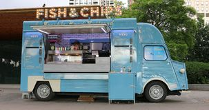 Fish And Chips Van Food Truck - Side View. London, UK, May 28, 2019: Fish And Chips Van Side View, Retro Blue Citroen H Food Truck On The Southbank Of The Thames stock video footage