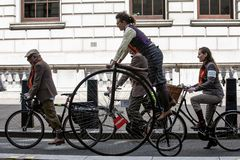 Metropolitan bicycle ride. People with old bicycles and clothes stock photography