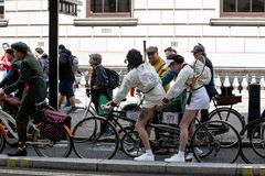 Metropolitan bicycle ride. People with old bicycles and clothes stock photos