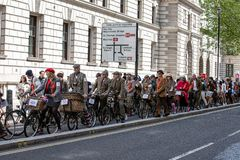 Metropolitan bicycle ride. People with old bicycles and clothes royalty free stock photography