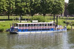 New Southern Belle paddle boat on River Thames outside Hampton Court Palace. London, Uk - May 11, 2018. LONDON, UK - May 11, 2018. New Southern Belle paddle boat royalty free stock images