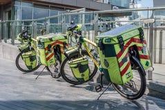 LONDON, UK - MAY 12, 2016: Paramedic ambulance biycles parked by. The Thames royalty free stock photography
