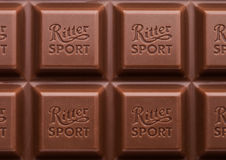 LONDON, UK - MAY 15, 2017:  Ritter Sport milk chocolate bar macro with logo. Ritter Sport chocolate bar made by Alfred Ritter GmbH Royalty Free Stock Photography