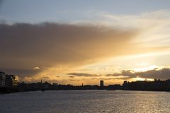 Sunset over the London cityscape across the River Thames, London, England, UK, May 20, 2017. LONDON, UK - MAY 20, 2017. Sunset over the London cityscape across royalty free stock images