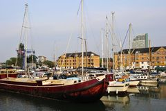 Boats in marina and houses London UK royalty free stock photos