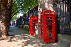 Traditional vintage red K6 telephone kiosk in front of the British Museum royalty free stock images