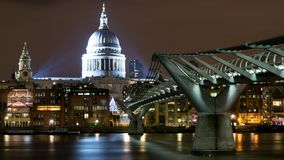 London UK. Night view of St.Paul`s Cathedral and the Millennium Bridge from the South Bank. royalty free stock photo