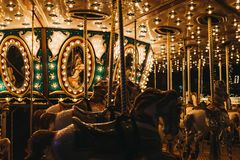 Close up of illuminated merry-go-round at Winter Wonderland Christmas Fair in London, UK. royalty free stock images