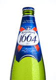 LONDON, UK- NOVEMBER 15 ,2016. Cold bottle of Kronenbourg 1664 beer on white background. A 5.5% pale lager is the main brand of Kr Stock Image