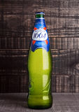 LONDON, UK- NOVEMBER 15 ,2016. Cold bottle of Kronenbourg 1664 beer on wooden background. A 5.5% pale lager is the main brand of K Stock Image