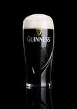 LONDON, UK - NOVEMBER 29, 2016: Glass of Guinness original beer on black background. Guinness beer has been produced since 1759 in Royalty Free Stock Photo