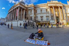Indian man with specific pictures in front of National Gallery, Royalty Free Stock Image