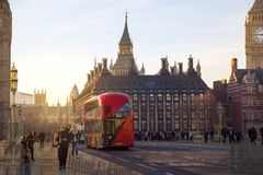 Multiple exposure image of beautiful morning on the Westminster bridge with blur of walking people. View include Big Ben and House Stock Photography