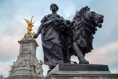 Bronze statues around the Queen Victoria Memorial in front of th. LONDON, UK - NOVEMBER 29, 2017: One of four bronze statues around the Queen Victoria Memorial Stock Photography