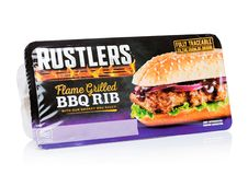 LONDON, UK - NOVEMBER 01, 2018: Pack of Rustlers Flame Grilled BBQ Rib with sauce on white background. LONDON, UK - NOVEMBER 01, 2018: Pack of Rustlers Flame stock photography