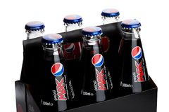 LONDON, UK - JUNE 9, 2017: Pack of six with glass Bottles of Pepsi Cola soft drink on white.American multinational food and bevera Stock Image