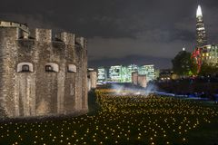 London, UK - November 7th 2018: Beyond The Deepening Shadow at the Tower of London - an installation of 10,000 flames to stock images