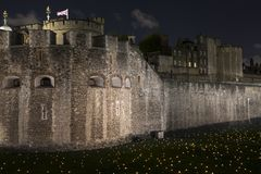 London, UK - November 6th 2018: Beyond The Deepening Shadow at the Tower of London - an installation of 10,000 flames to royalty free stock photo