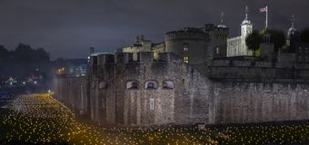London, UK - November 6th 2018: Beyond The Deepening Shadow at the Tower of London - an installation of 10,000 flames to royalty free stock images