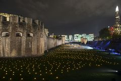 London, UK - November 7th 2018: Beyond The Deepening Shadow at the Tower of London - an installation of 10,000 flames to royalty free stock photos