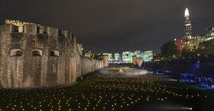 London, UK - November 7th 2018: Beyond The Deepening Shadow at the Tower of London - an installation of 10,000 flames to royalty free stock image