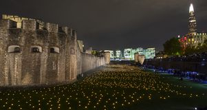 London, UK - November 7th 2018: Beyond The Deepening Shadow at the Tower of London - an installation of 10,000 flames to royalty free stock images