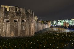 London, UK - November 7th 2018: Beyond The Deepening Shadow at the Tower of London - an installation of 10,000 flames to royalty free stock photography