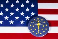 The State of Indiana in the USA. London, UK - November 20th 2018: The symbol of the State of Indiana, pictured over the flag of the United States of America stock photos