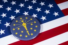 The State of Indiana in the USA. London, UK - November 20th 2018: The symbol of the State of Indiana, pictured over the flag of the United States of America stock photography