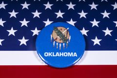 State of Oklahoma in the USA. London, UK - November 15th 2018: The symbol of the state of Oklahoma, pictured over the flag of the United States of America royalty free stock photography