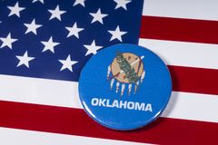 State of Oklahoma in the USA. London, UK - November 15th 2018: The symbol of the state of Oklahoma, pictured over the flag of the United States of America stock photo