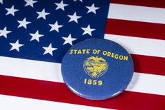The State of Oregon in the USA. London, UK - November 20th 2018: The symbol of the State of Oregon, pictured over the flag of the United States of America royalty free stock photo