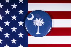 The State of South Carolina. London, UK - November 15th 2018: The symbol of the State of South Carolina, pictured over the flag of the United States of America stock photography