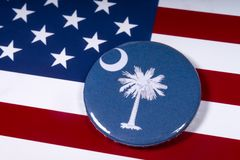 The State of South Carolina. London, UK - November 15th 2018: The symbol of the State of South Carolina, pictured over the flag of the United States of America stock image