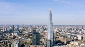 Aerial cinematic shot of the central London skyline feat. The Shard building royalty free stock photo