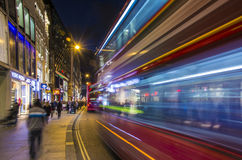 London, UK, October 05 2016: Crowded Oxford street in night,. London, UK, October 05 2016: Crowded Oxford street with city bus passing by at night Stock Photo